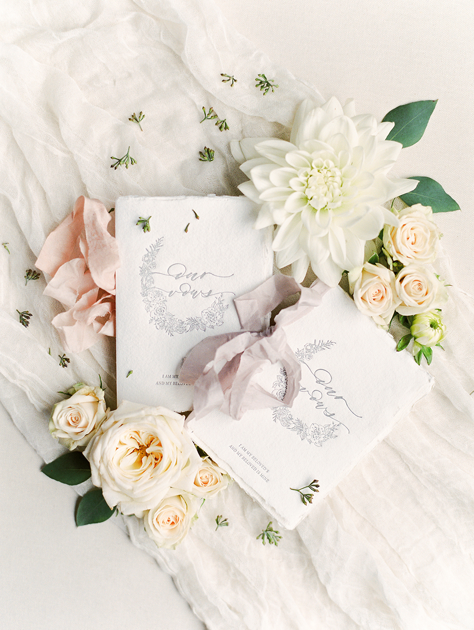 Invitations and florals from Stephanie and Nyles' wedding.