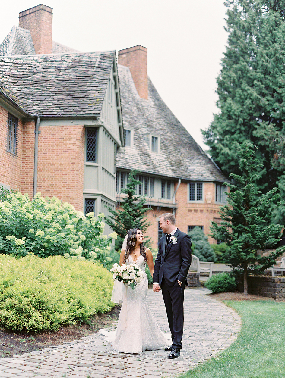 Stephanie and Nyles walk the grounds during their Fir Acres Estate Gardens wedding