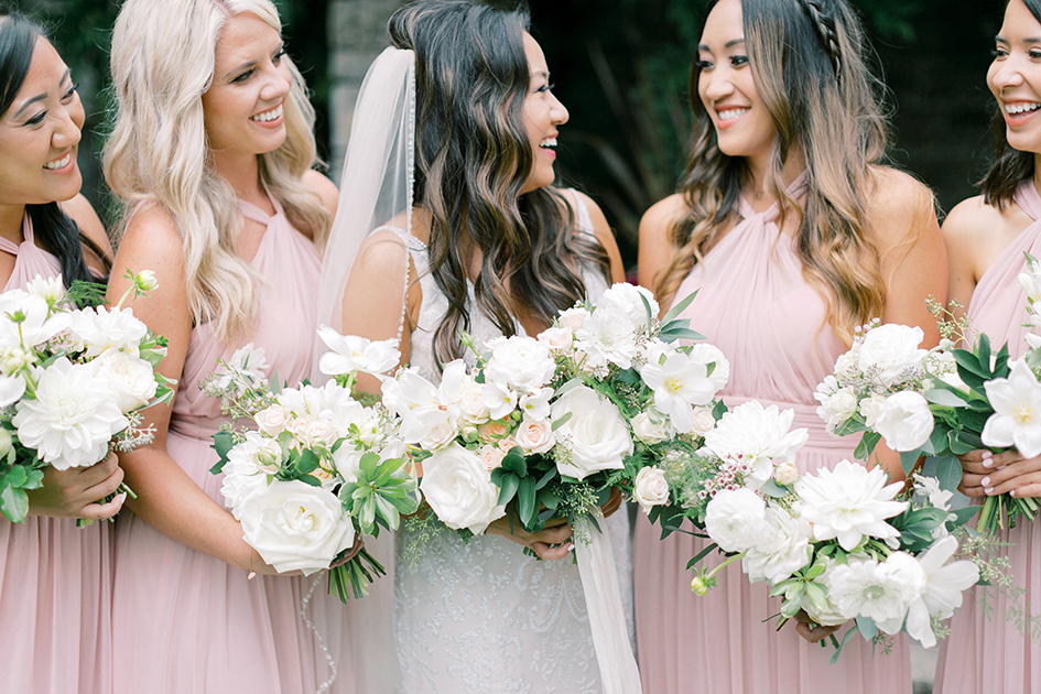 Stephanie and her bridesmaids show off their bouquets.