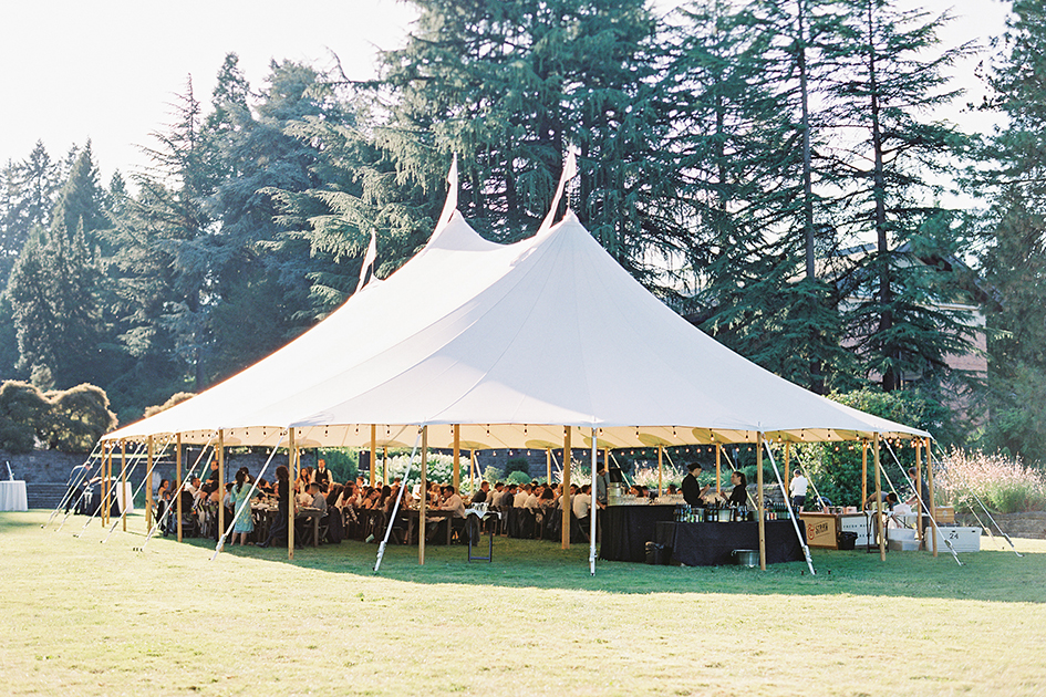 The dinner tent at Fir Acres Estate Gardens filled with guests.