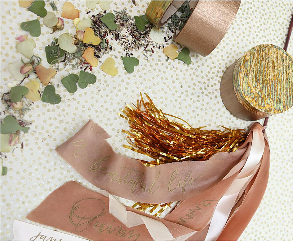 Ribbon wants, natural confetti and metallic streamers all make for great wedding exit options