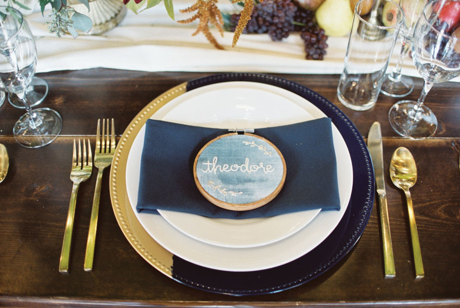 Beautiful needlework serves as place cards at the reception