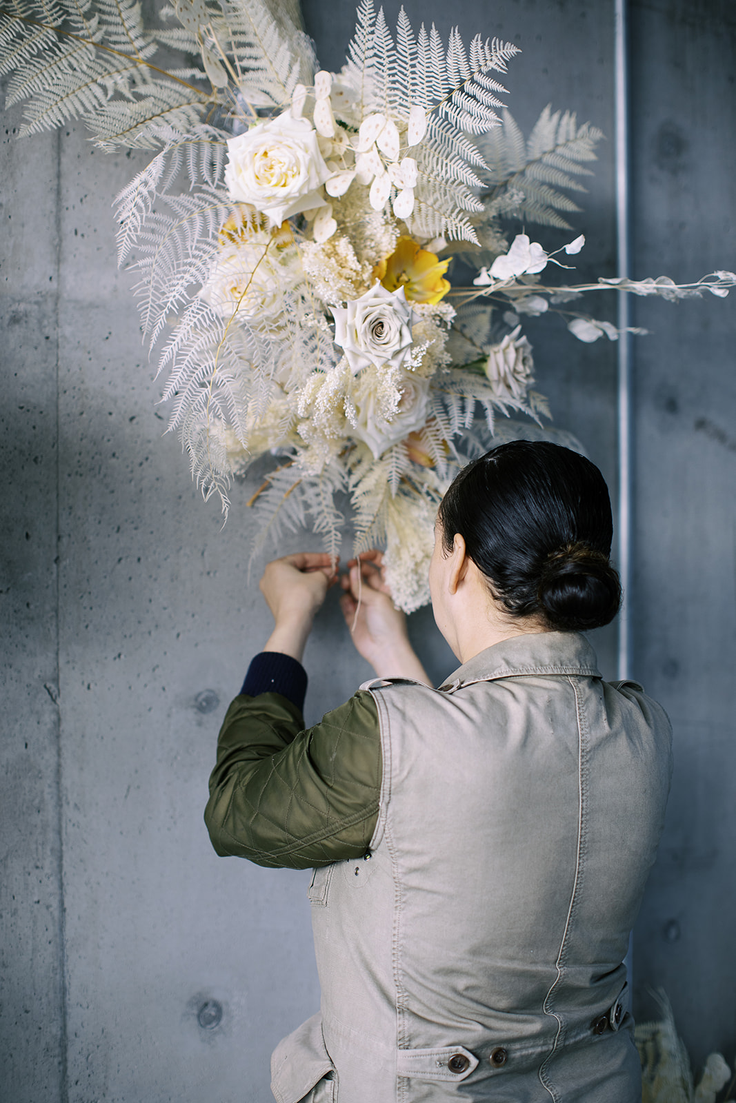 Chas Thompson of Wildflower Portland works with a floral installation of her design.