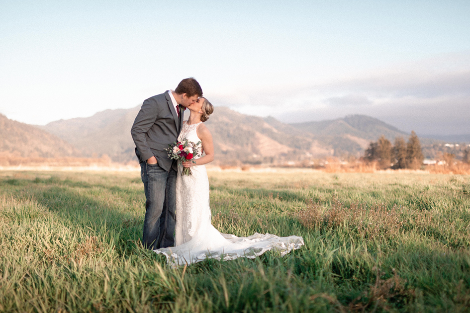 Hayley and Luke kissing after their ceremony on the family farm in Tillamook, Oregon.
