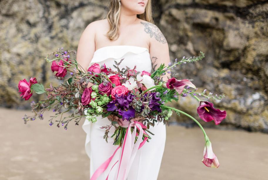 BLUE Floral Company designed a sprawling pink and purple bridal bouquet