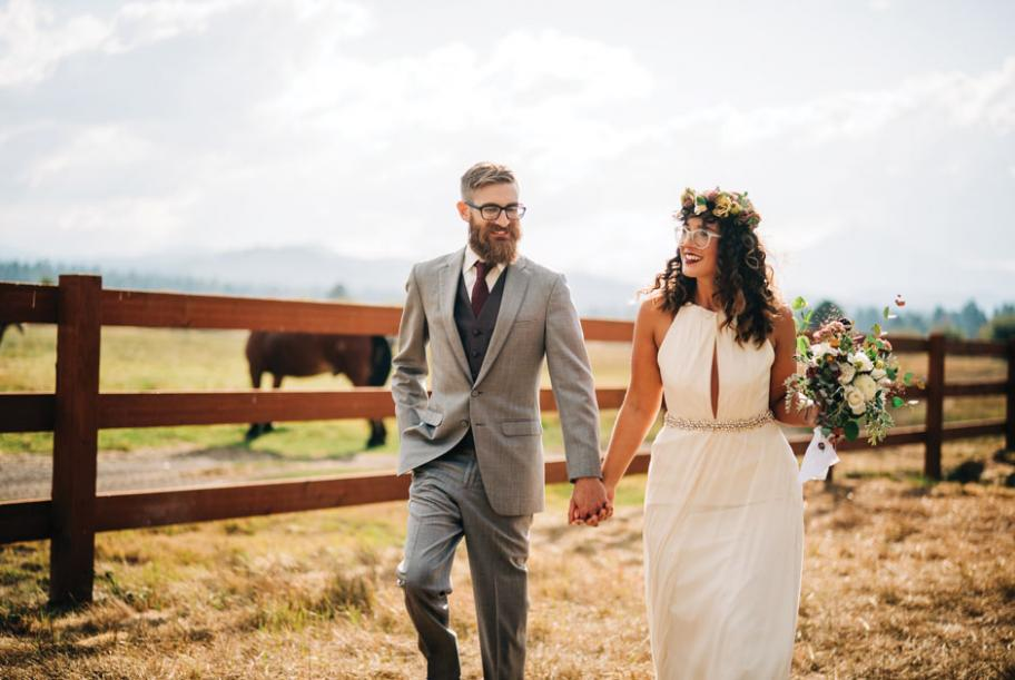 The couple walks together at FivePine Lodge