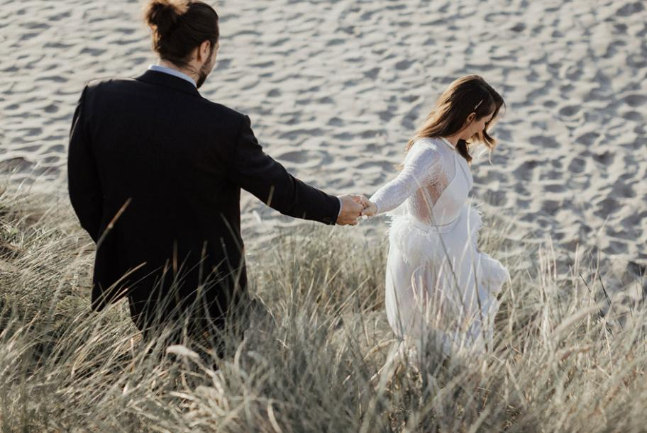Rachel and Nate run to the beach near Proposal Rock for their first look